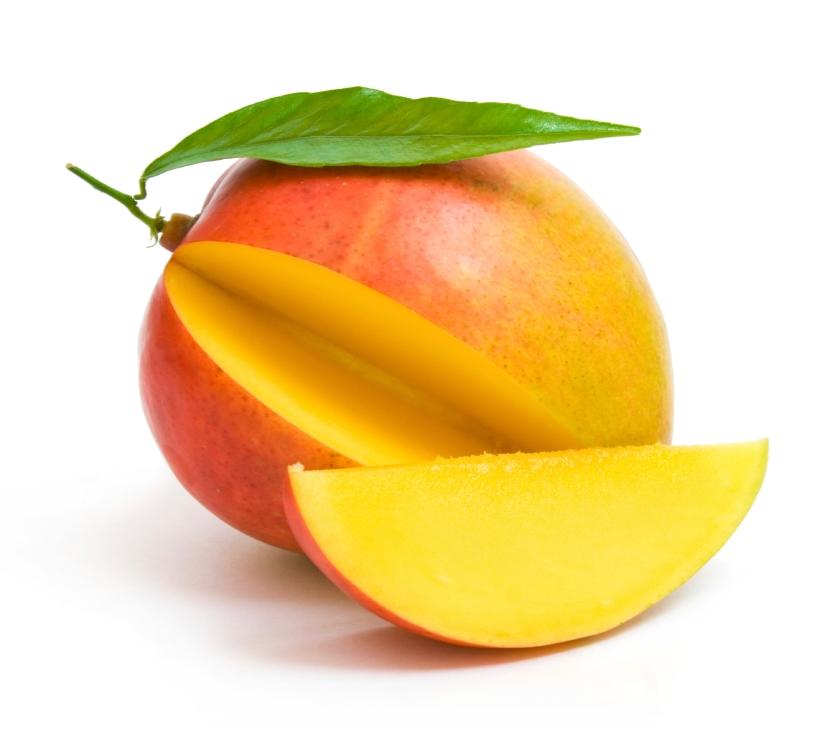 mango with a leaf and a slice