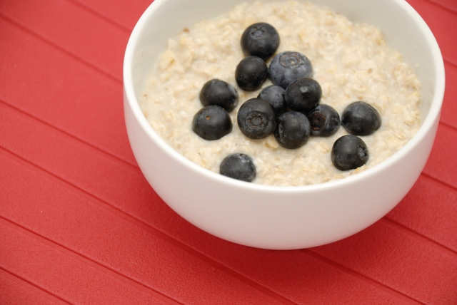 Blueberries and oatmeal in white bowl