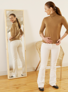 woman trying pants in mirror iStock_000033987490Small